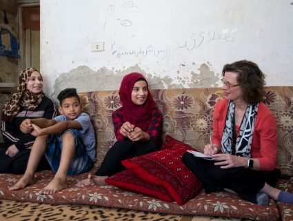 Michelle Nunn, president and CEO of CARE USA, meets with the family of young filmmaker Walaa, 15, and her brother who appears in the film, Nasr, 12, in Azraq town, Jordan on June 20, 2018. photo Carey Wagner/CARE